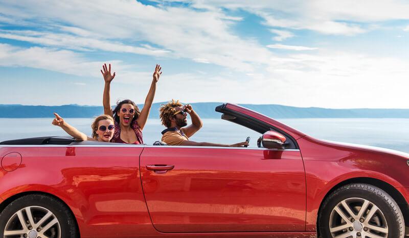 Friends riding in a open top car