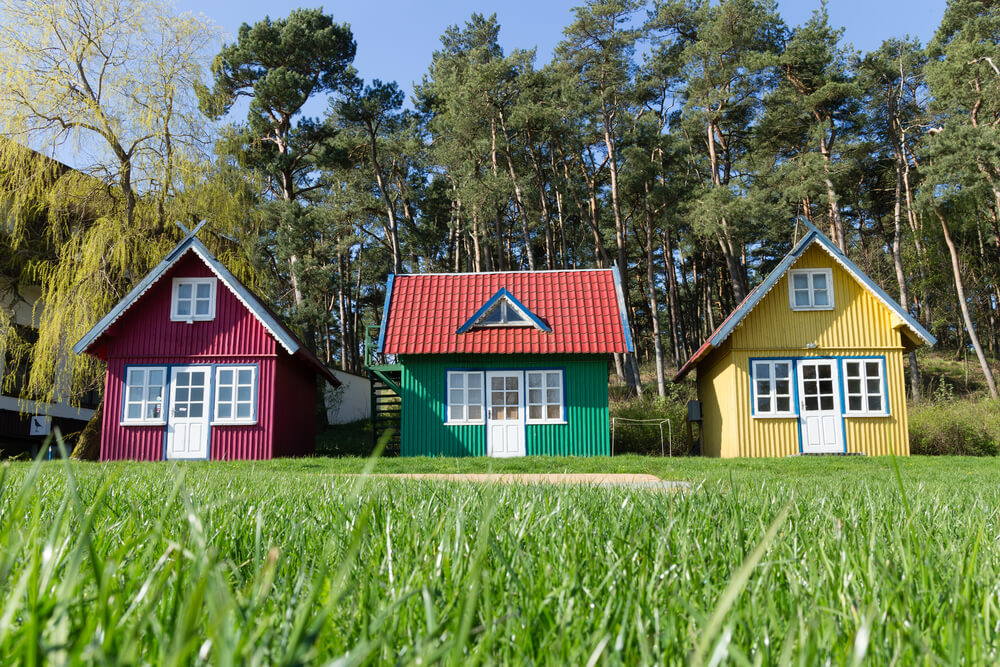 three tiny houses in the woods