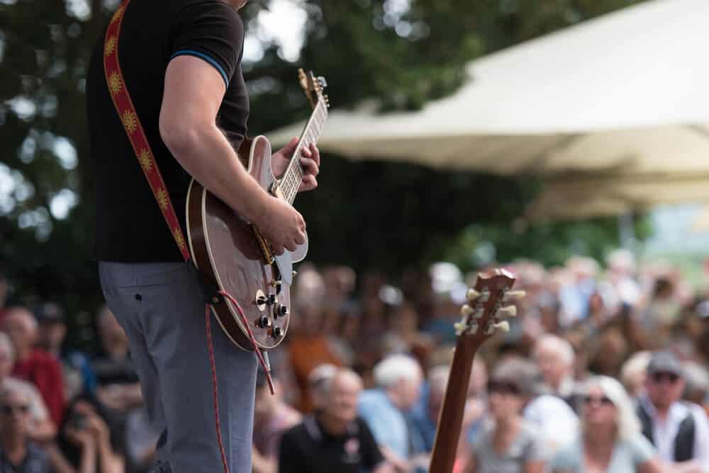 outdoor concert focus on guitar player