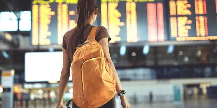 girl wearing backpack at airport