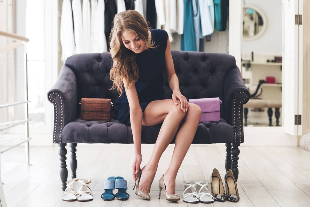 young woman selecting shoes