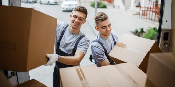 handsome movers loading truck