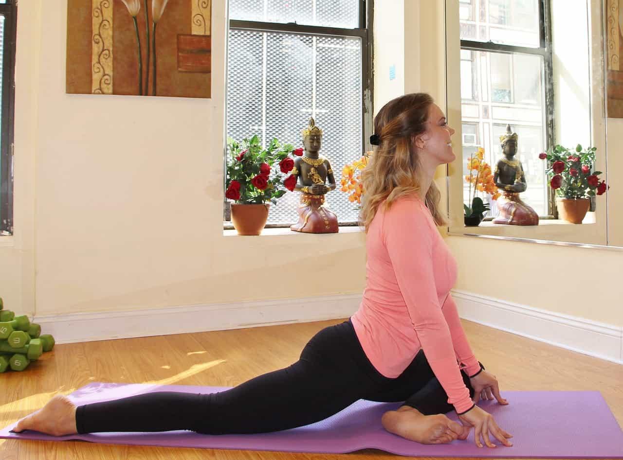 woman doing yoga in studio setting