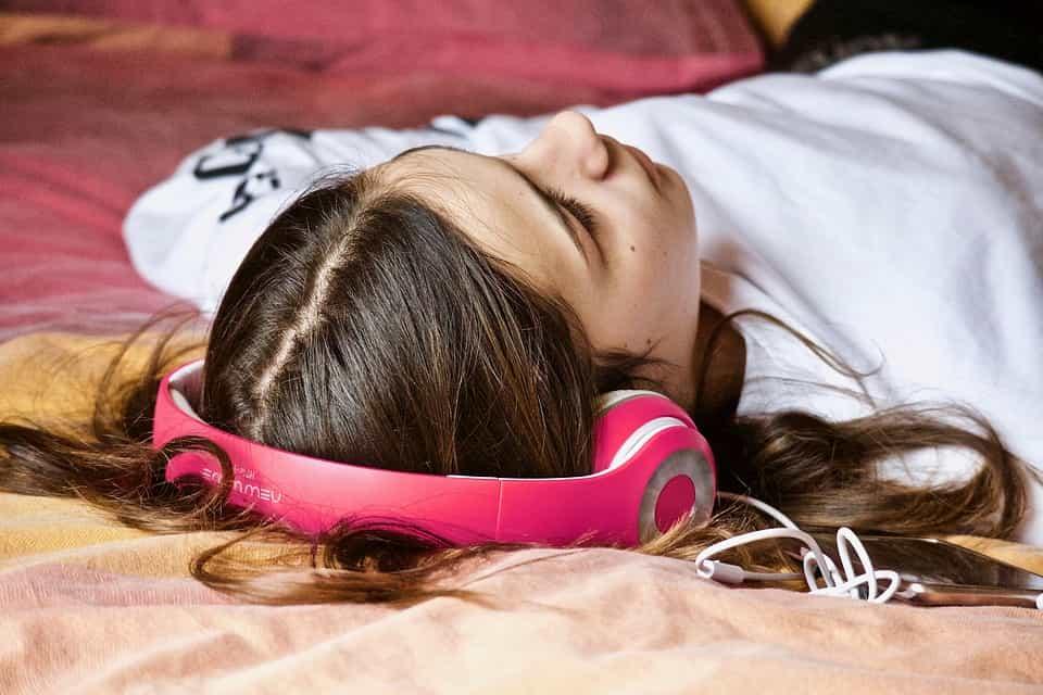 woman lying down headphones on