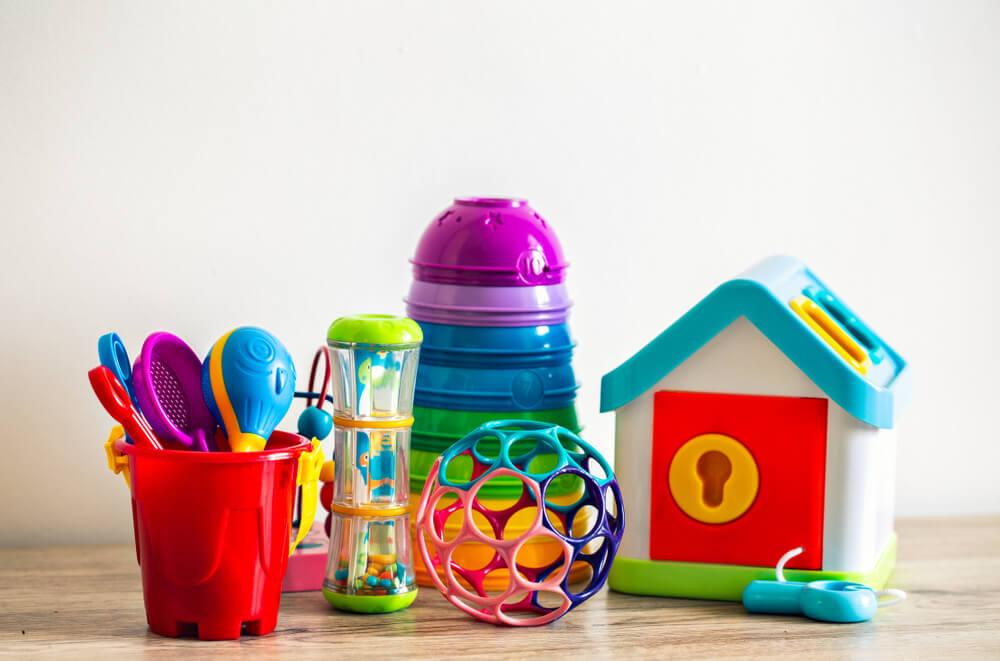 baby toys arranged on floor