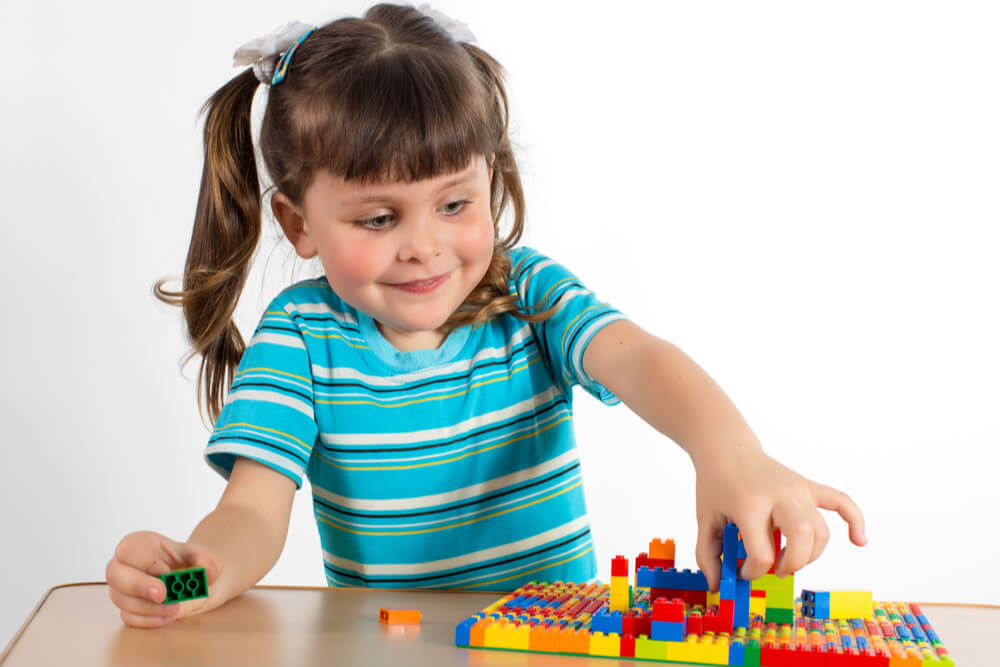 child playing with lego set