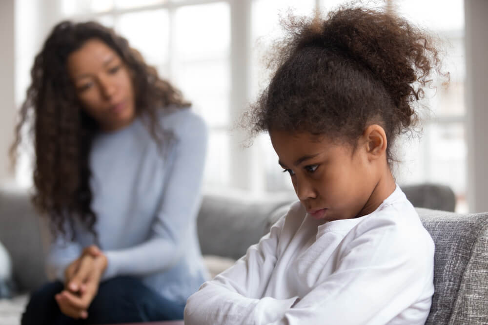 child refusing help from mother