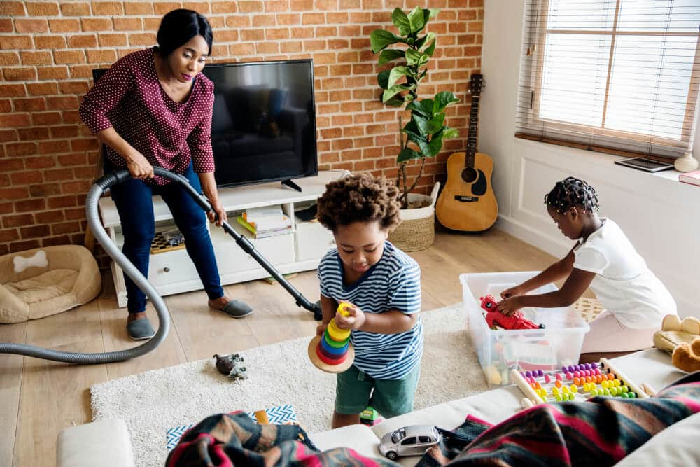family cleaning lving room together