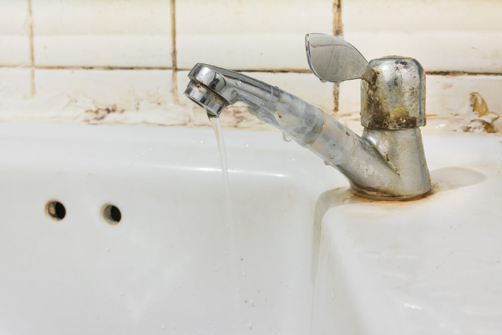 dirty grime covered bathroom tap
