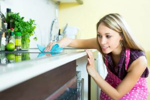 finishing touches on cleaning kitchen