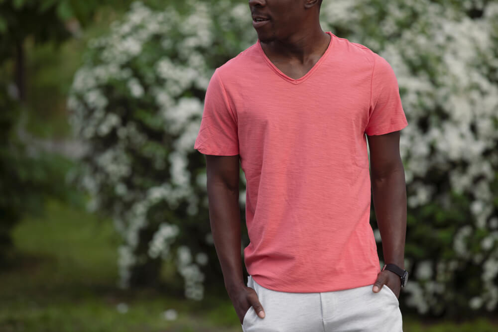 man in light colored shirt pants