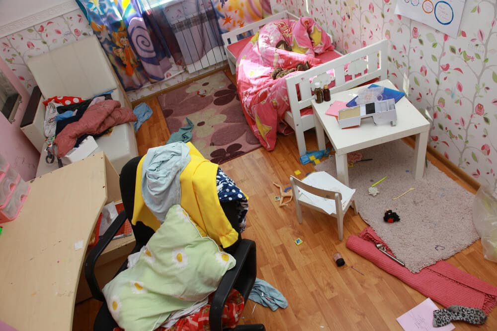 messy kids room cluttered by toys