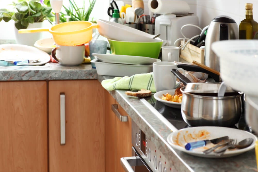 piles of dirty dishes in kitchen