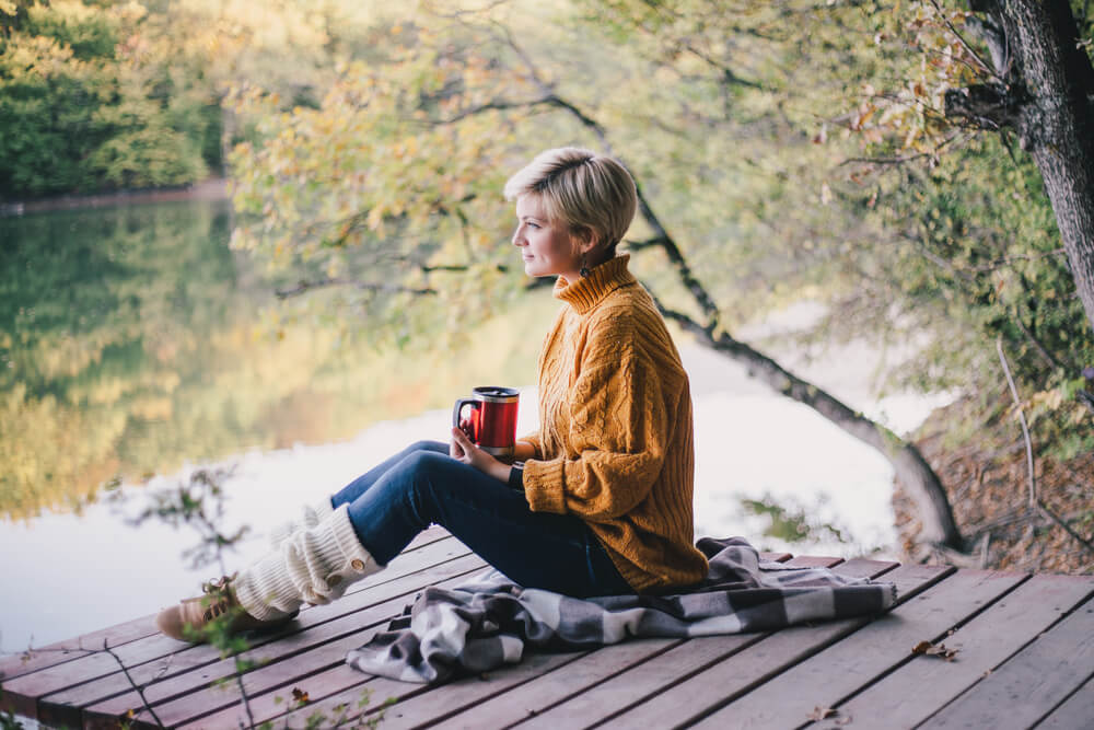 woman wearing oversized sweater outside